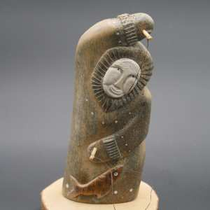 Whale Bone Fisherman Carving