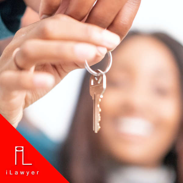 two people holding the keys to their new home