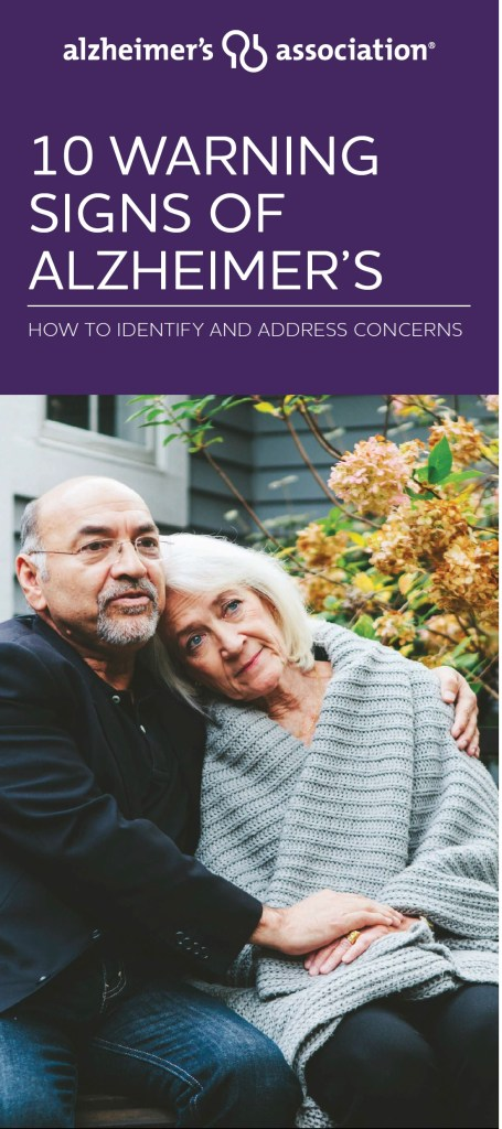 Booklet has picture of man and woman, sitting outside, her head on his shoulder and she's wearing a knitted gray shawl. He is wearing glasses and a black jacket, with his arm around her. They are seniors.