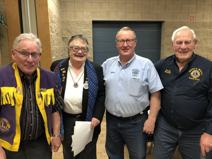 Lion Ken McConnell, DG Barb Tuxford, Lion Glenn Phillips and Lion George Kennedy