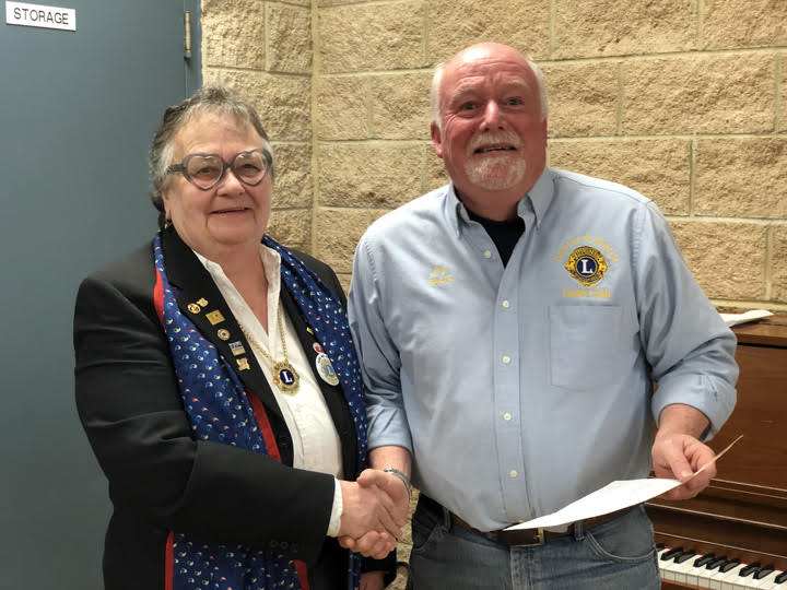 District Governor Barb Tuxford and Lion Jim Reeve