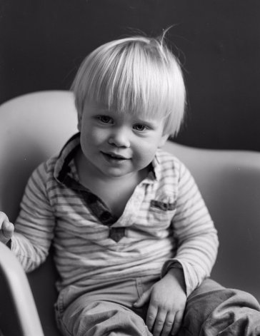 Black AND white photo of young boy shot on large format HP5 flim by @biotecbob