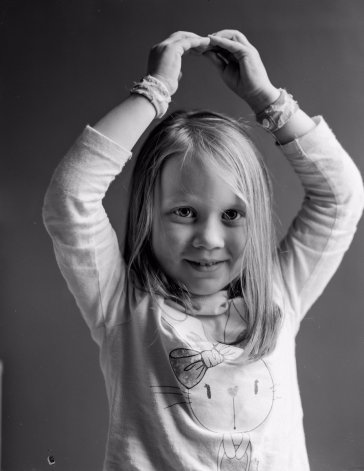 Black AND white photo of young girl shot on large format HP5 flim by @biotecbob