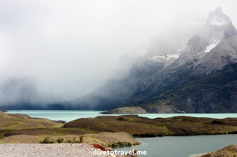 Foggy view of the Torres del Paine in Chile's Patagonia with lake in front