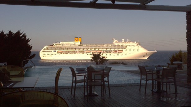 View of a cruise ship from resort in Mykonos, Greece
