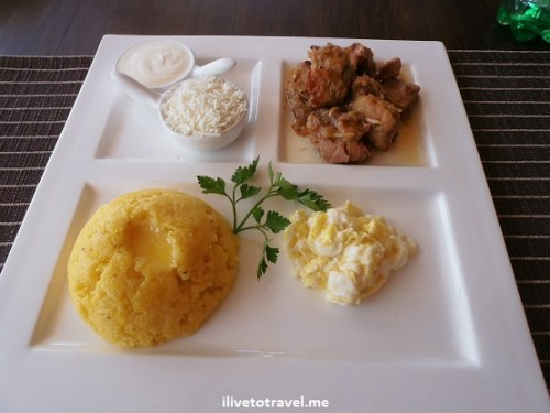 Mamaliga (polenta) and pork - typical food dish from Moldavia, Moldova, Romania