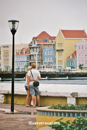 Couple enjoying the view of Punda across from Otrobando in Willemstad, Curacao