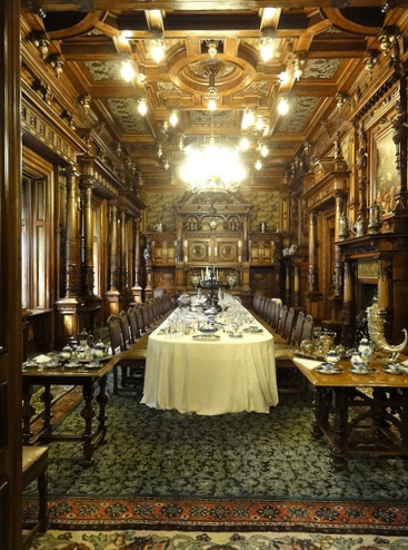 The majestic dining room at Peles Castle in Romania