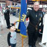 British Legion official Terry Hall and a youngster at the Beating Retreat and Su…