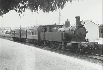 P09355 - Morning train from Scarborough to Port Kembla at Thirroul Railway Station, c.1964