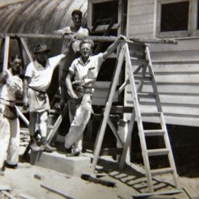 1951 - Wally Powell (hat) with workmates constructing a new igloo in Walker St Helensburgh