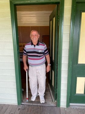 Tony at the door of his old house