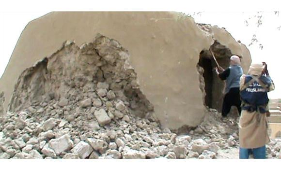 Militants destroying a shrine in Timbuktu in July, 2012