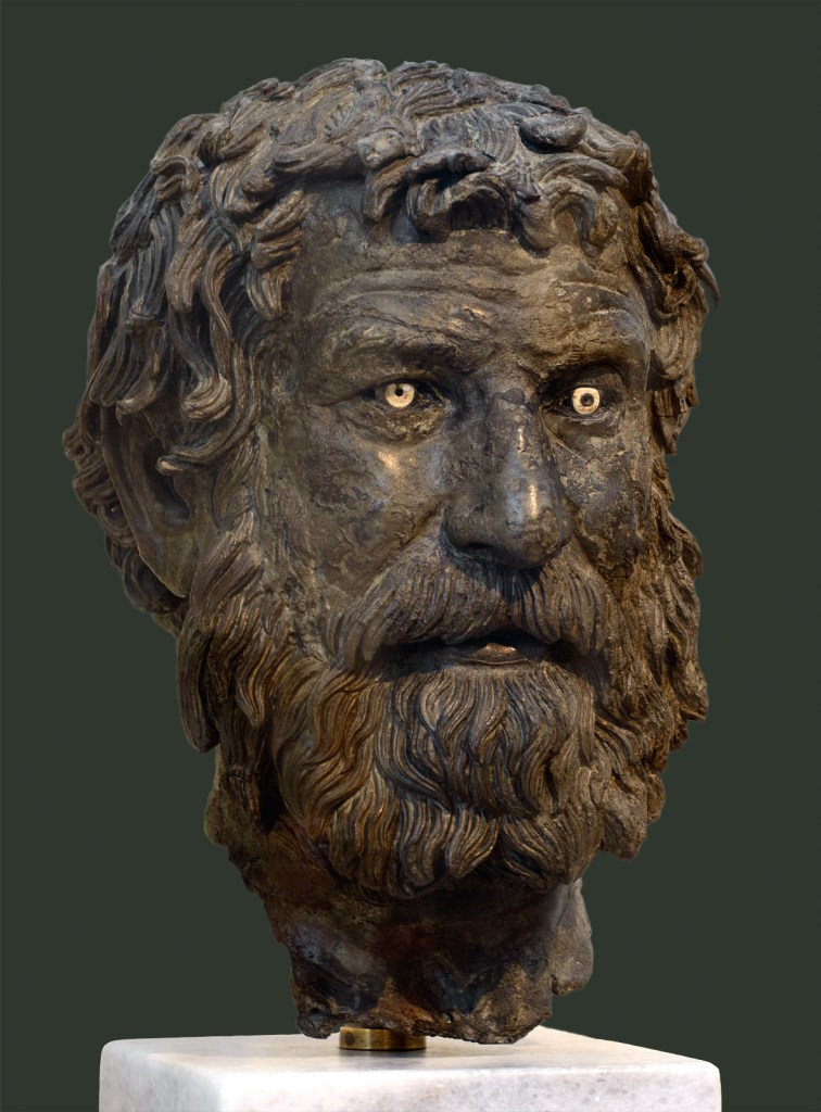 """The """"Philosopher of Anthykera"""", a 3rd Century BCE bronze head discovered near the Anthykera shipwreck."""