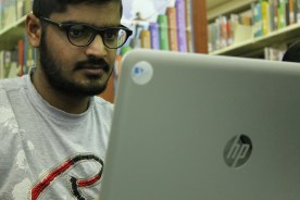 Gayabhrl, computer technology master's student, studies in Booth Library.