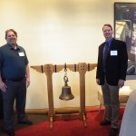 Jeff Perkis, left, Second Place Furniture for his red oak bell stand, with John Lough, chair of the Urban Wood Products Showcase.