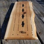 Wood from the Hood sells this white oak live edge cribbage board and other products at retail outlets and online.