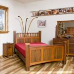 Black walnut with cherry accents adorns this urban wood bedroom set.  Each piece was assembled using traditional dovetail joinery.