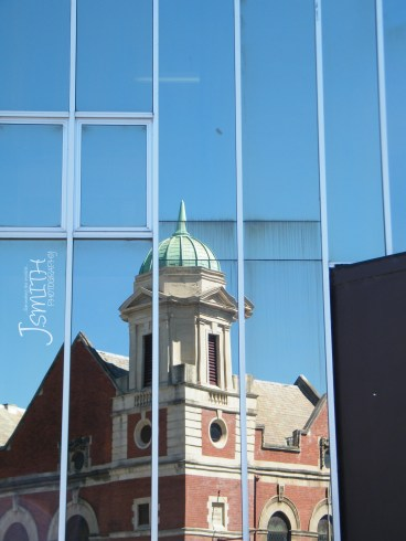 The contrast of new & old architecture through reflection.