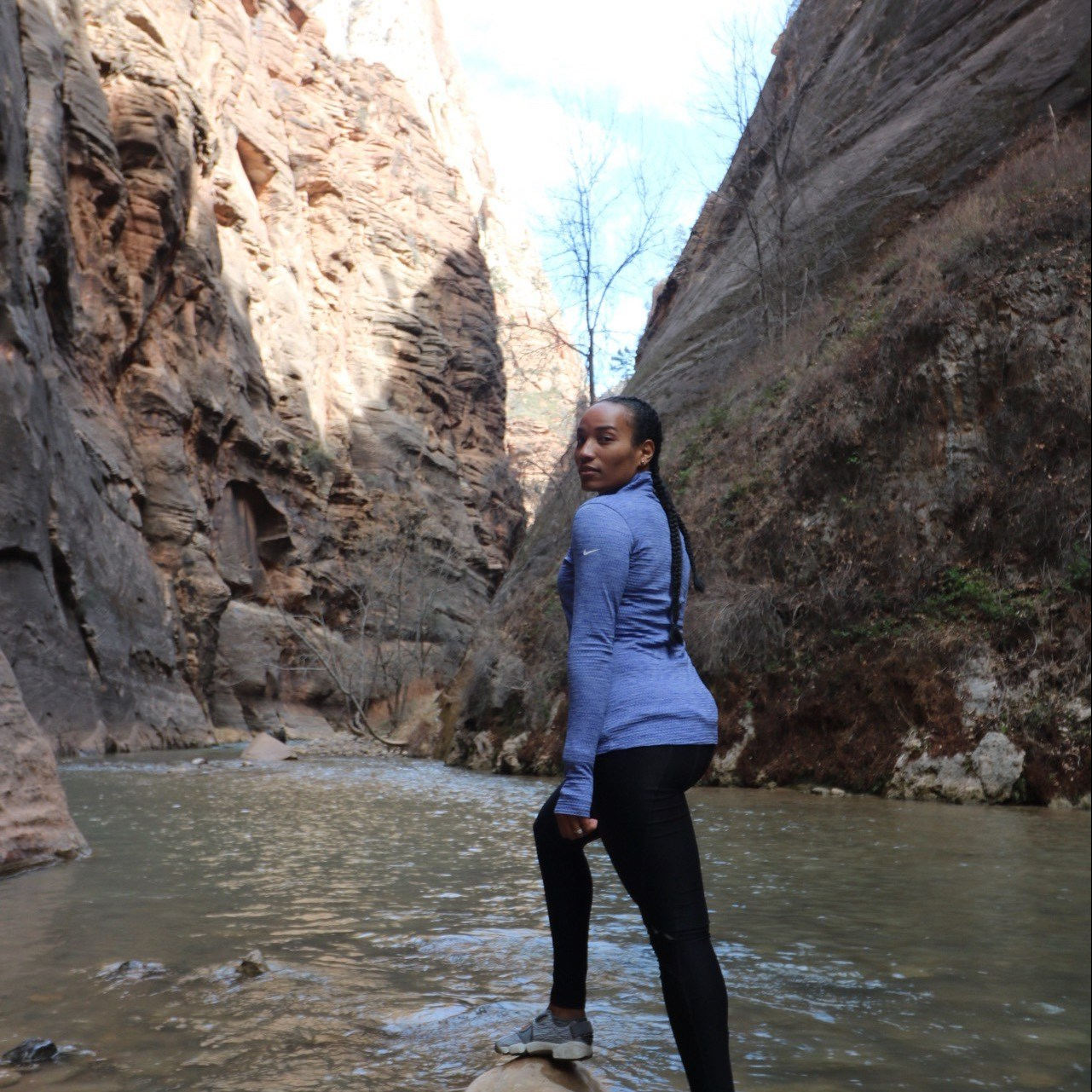 Illustrated by Sade - Woman taking a photo in the river at the Narrows