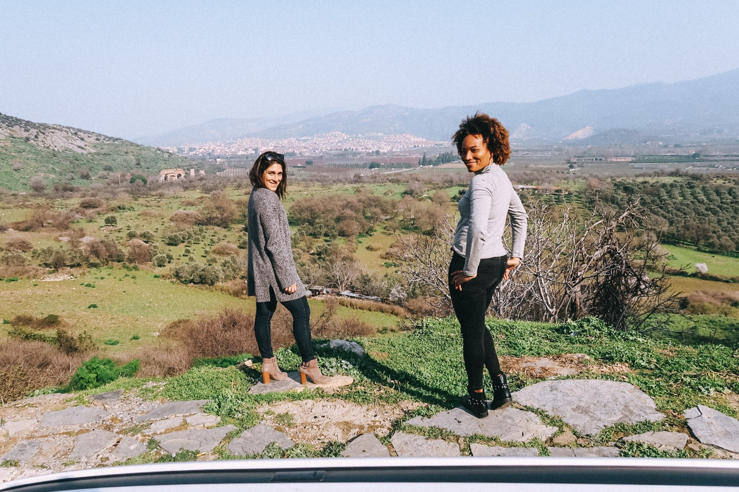 Illustrated by Sade - My girl friend and I posing for a photo in front of a view of the countryside of Ephesus, Turkey