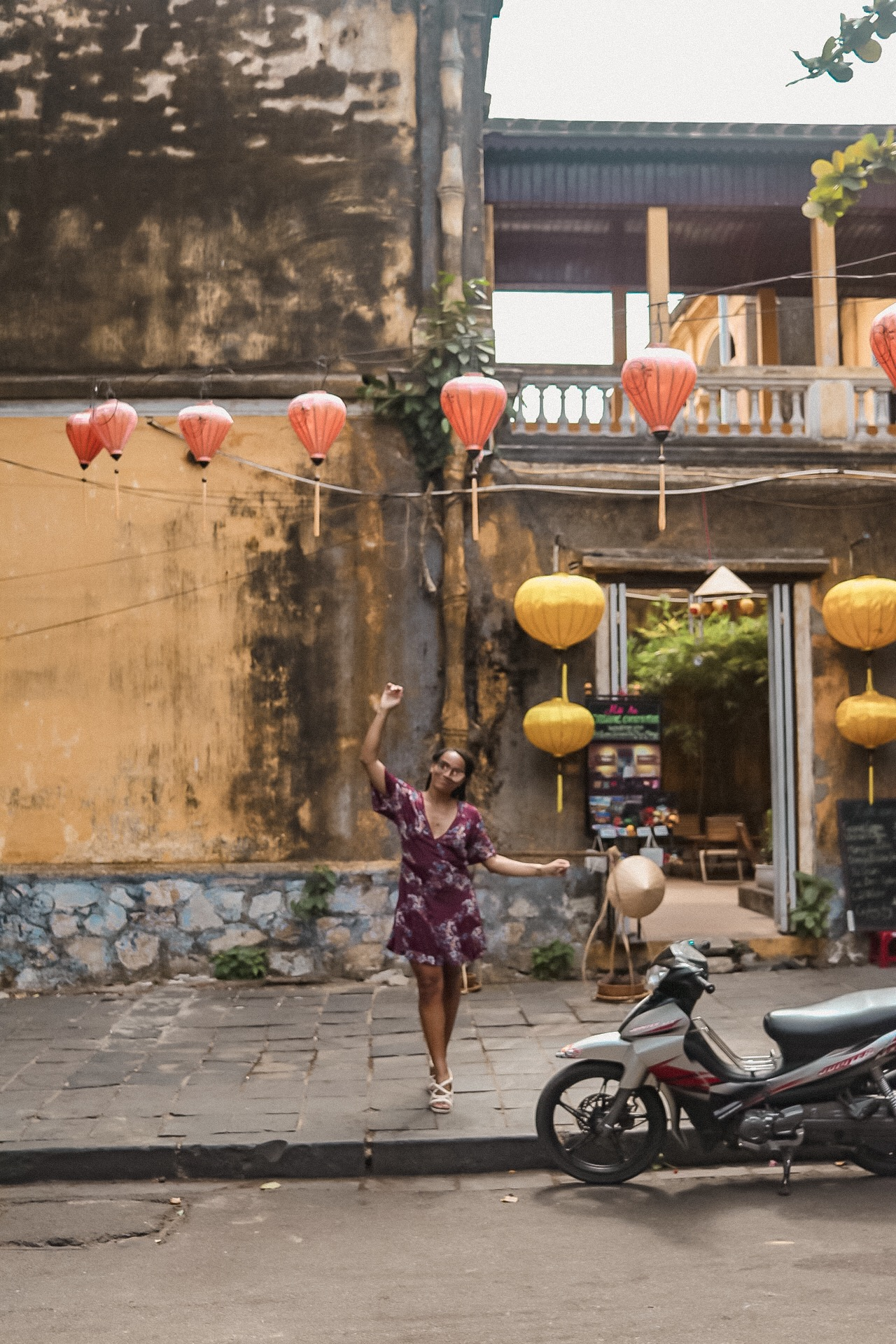 Illustrated by Sade - Yellow-painted building and lanterns in Hoi An, Vietnam