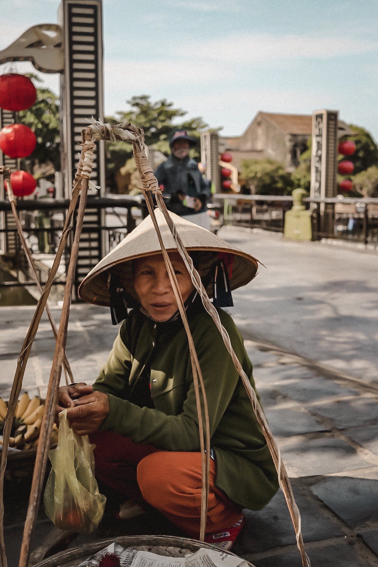 Illustrated by Sade - Elderly Vietamese Woman Selling Fruit on the Streets of Hoi An, Vietnam