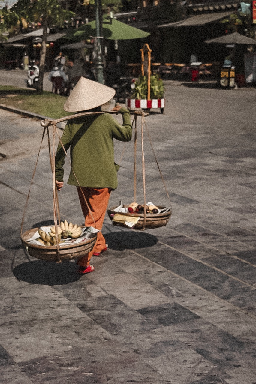 Illustrated by Sade - Elderly Vietnamese Woman Selling Fruit on the Streets of Hoi An, Vietnam