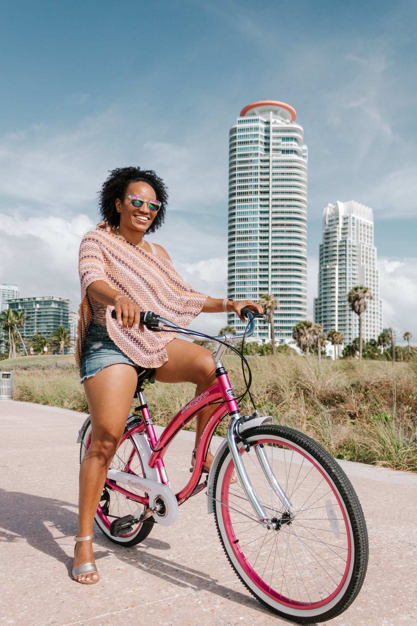 Illustrated by Sade - Woman bike riding in South Point Park in South Beach, Miami