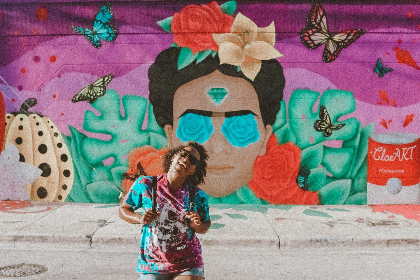 Illustrated by Sade - Woman taking photo in front of a Frida Kahlo mural in Wynwood