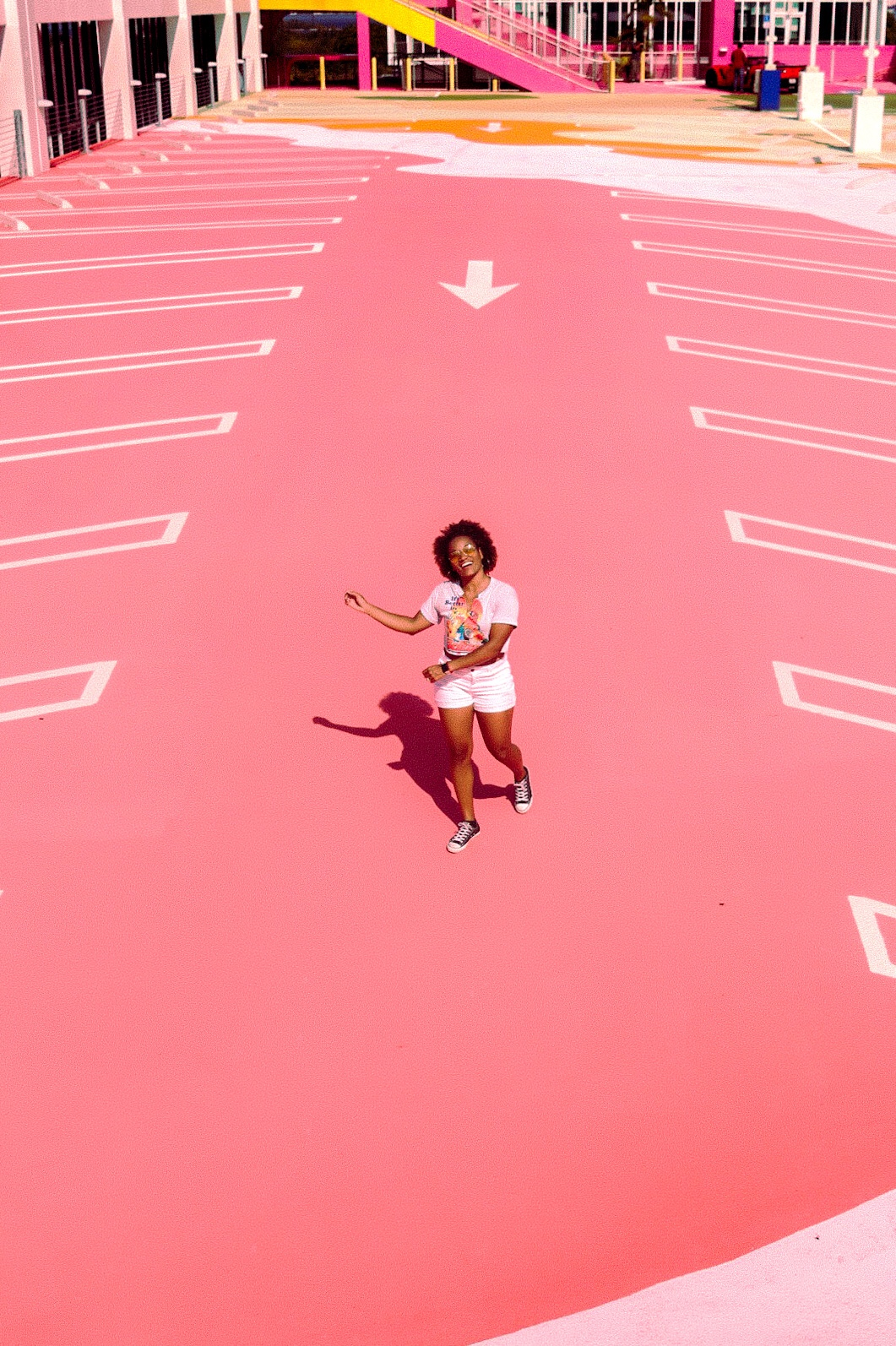 Illustrated by Sade - Woman taking a photo on the pink roof top of Museum Garage