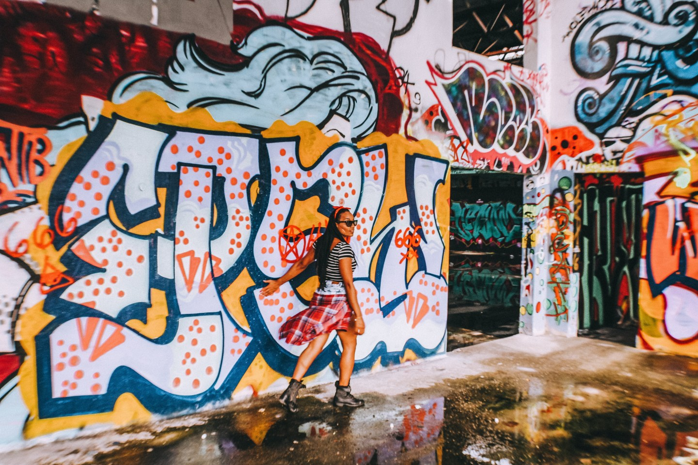 Illustrated by Sade - Woman taking a photo in an abandoned warehouse in Wynwood, Miami, Florida