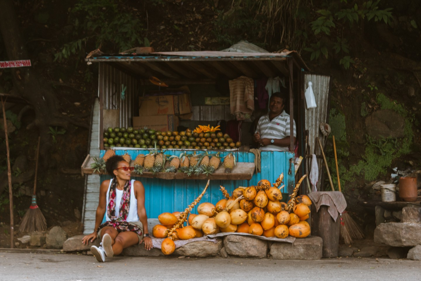 Illustrated by Sade - Woman sitting near fruit stand in Ella, Sri Lanka.