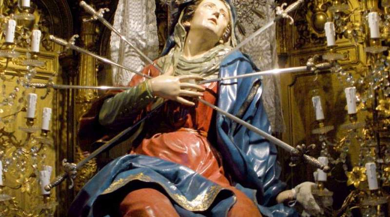Seven Swords Piercing the Sorrowful Heart of Mary. Church of the Holy Cross, Salamanca, Spain. Photo of statue by Zarateman, CC BY-SA 4.0, Courtesy of Wikipedia. Via IllustratedPrayer.com