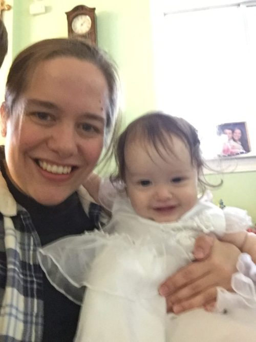 A picture for you! This is my daughter trying out her baptism gown to make sure it still fits. It does! Barely...
