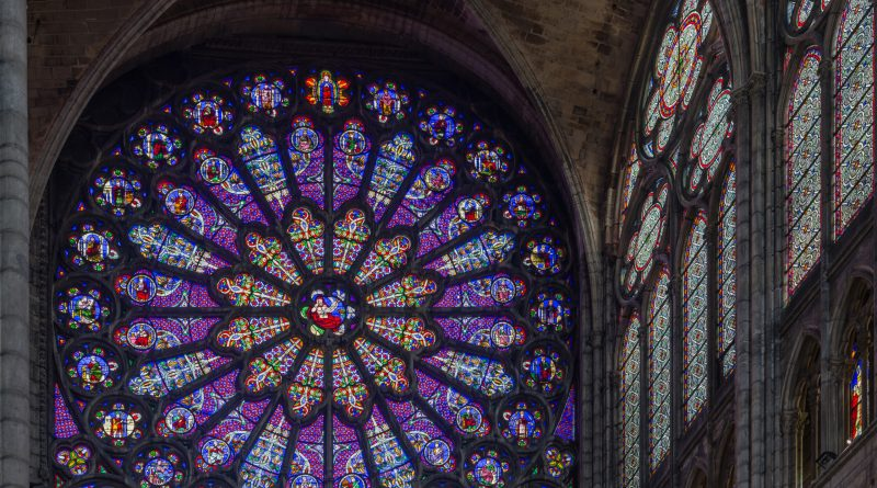 The stained glass rose window of the north transept of the Basilica of Saint Denis in Paris, France. Photo by David Iliff. License: CC BY-SA 3.0