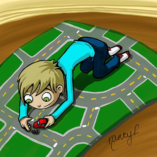 Garçon qui joue aux petites autos sur son tapis d'auto