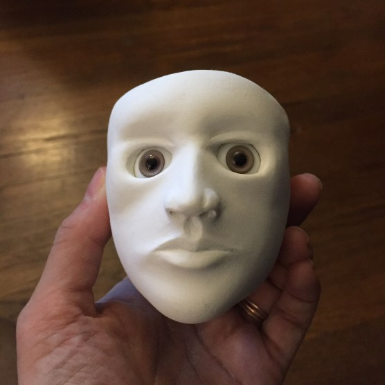 Completed face with eyes.