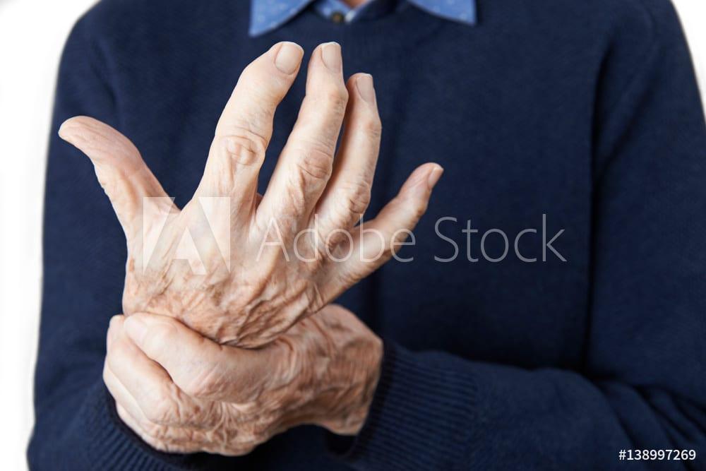 Close Up Of Senior Man Suffering With Arthritis