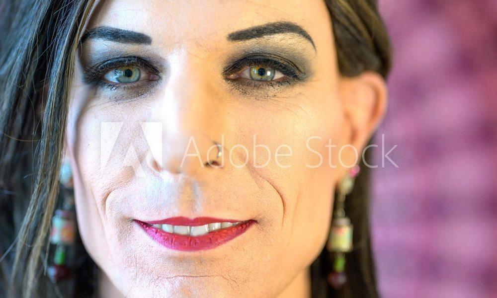 Face portrait of a smiling transgender
