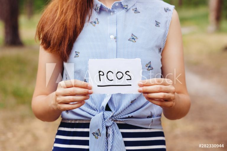 PCOS - Polycystic ovary syndrome, woman hormone sickness lettering on paper in womans hands