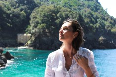 Joy against the aqua water of San Fruttuoso