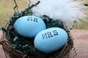 Mr and Mrs stamped wooden painted eggs in nest