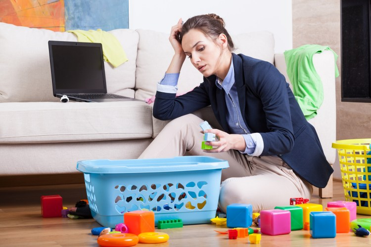 "Woman sitting on floor, surrounded by toys and baskets as she works on her laptop.   <!-- HTML Credit Code for Can Stock Photo --> <a href=""https://www.canstockphoto.com"">(c) Can Stock Photo / Bialasiewicz</a>"