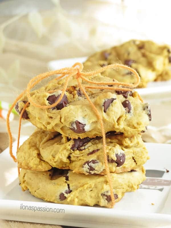 Stack of 3 cookies with chocolate chips.