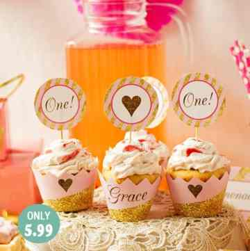 Dulce de leche cupcakes in a pink and gold party set up.