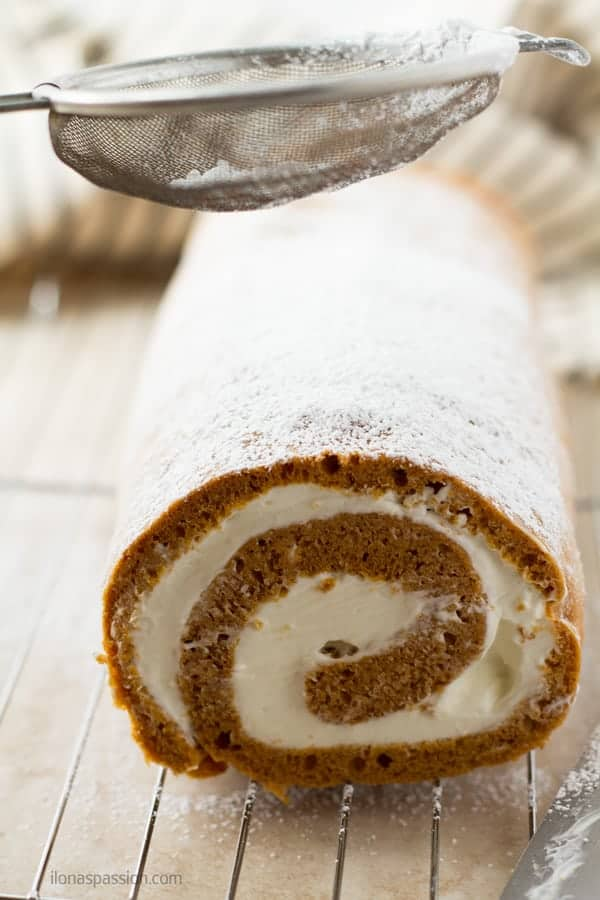 Roll cake dusted with powdered sugar.