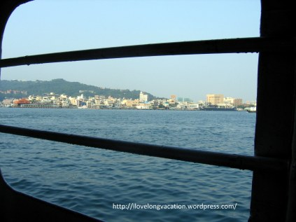 Crossing the waters to Cijin. View of the island from the ferry.