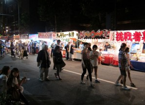 Night bazaar with food and game stalls