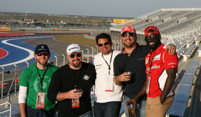 Group of friends smiling for a picture at the United States Grand Prix